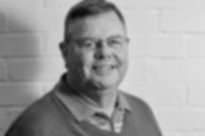 Headshot of a man wearing glasses. Commercial photographer. Commercial photography. Headshot photographer. Headshot photography. Cambridge. London. United Kingdom. East Anglia. Staff headshots. Employee headshots.