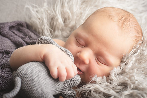 Sleeping baby. Newborn photographer. Newborn photography. Baby photography. Baby photographer. Natural newborn photography. Cambridge. London. United Kingdom. UK. Portrait Photographer.