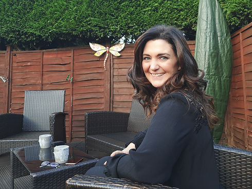A smiling businesswoman outdoors. Personal brand photoshoot. Online personal brand photoshoot. Online photoshoot. Online photographer. Online photography. Business photography. Small business owner.