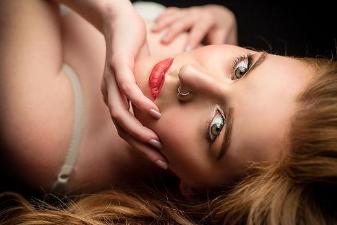 Redhead beauty. Boudoir photography. Boudoir photographer. Lingerie photography. Lingerie photographer. Bridal boudoir. Mandoir. Couple boudoir. Cambridge. London. United Kingdom. UK. Glamour Photography. Glamour Photographer. Fine art nude photography. Fine art implied nude photography.