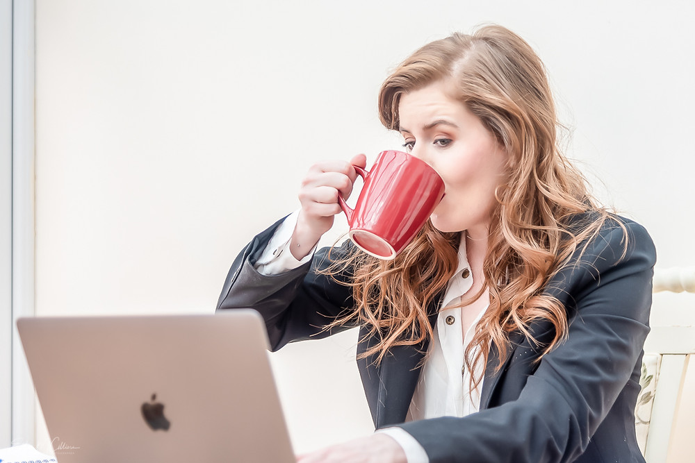 A redhead woman drinks coffee during a personal brand photoshoot. Online personal brand photoshoot. Online personal brand. Personal brand. Business photography. Business photographer. Small business photographer. Small business photography. Freelance. Freelances. Support small business.