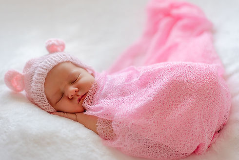 baby girl in pink. Newborn photographer. Newborn photography. Baby photography. Baby photographer. Natural newborn photography. Cambridge. London. United Kingdom. UK. Portrait Photographer.