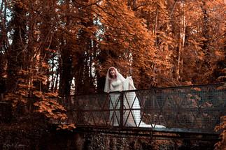 Runaway bride on a bridge