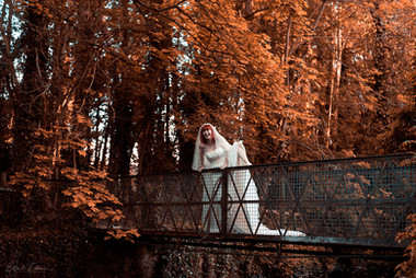 Runaway bride on a bridge