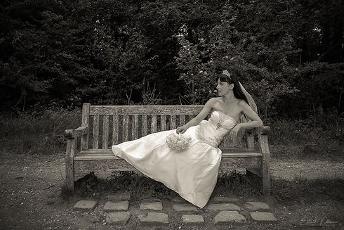 A bride rests on a bench. Wedding photographer. Wedding photography. Portrait photographer. Portrait photography. Portrait Photoshoot. Family photography. Family photographer. Family photoshoot. Photoshoot. Cambridge. London. United Kingdom. UK. People photographer. People photography. Fine art photography. Fineart photography. Fine art photographer. Fine art photography.
