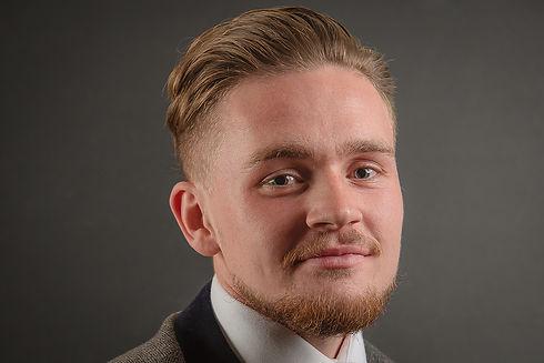 Young man headshot. Commercial photographer. Commercial photography. Headshot photographer. Headshot photography. Cambridge. London. United Kingdom. East Anglia. Staff headshots. Employee headshots.