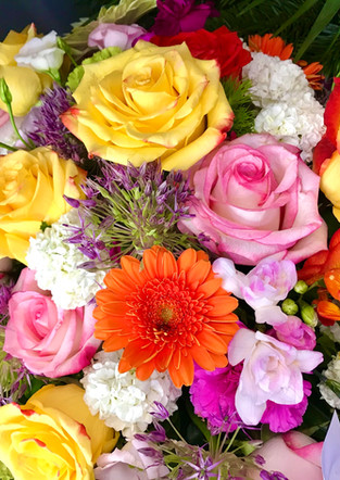 Fellner Blumen Trauerfloristik Kranz bunt