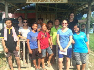 Claire Mitchell, Simone Bova, Stephanie Triefus, Elizabeth King, and the youth of Mangkadait village, Borneo.