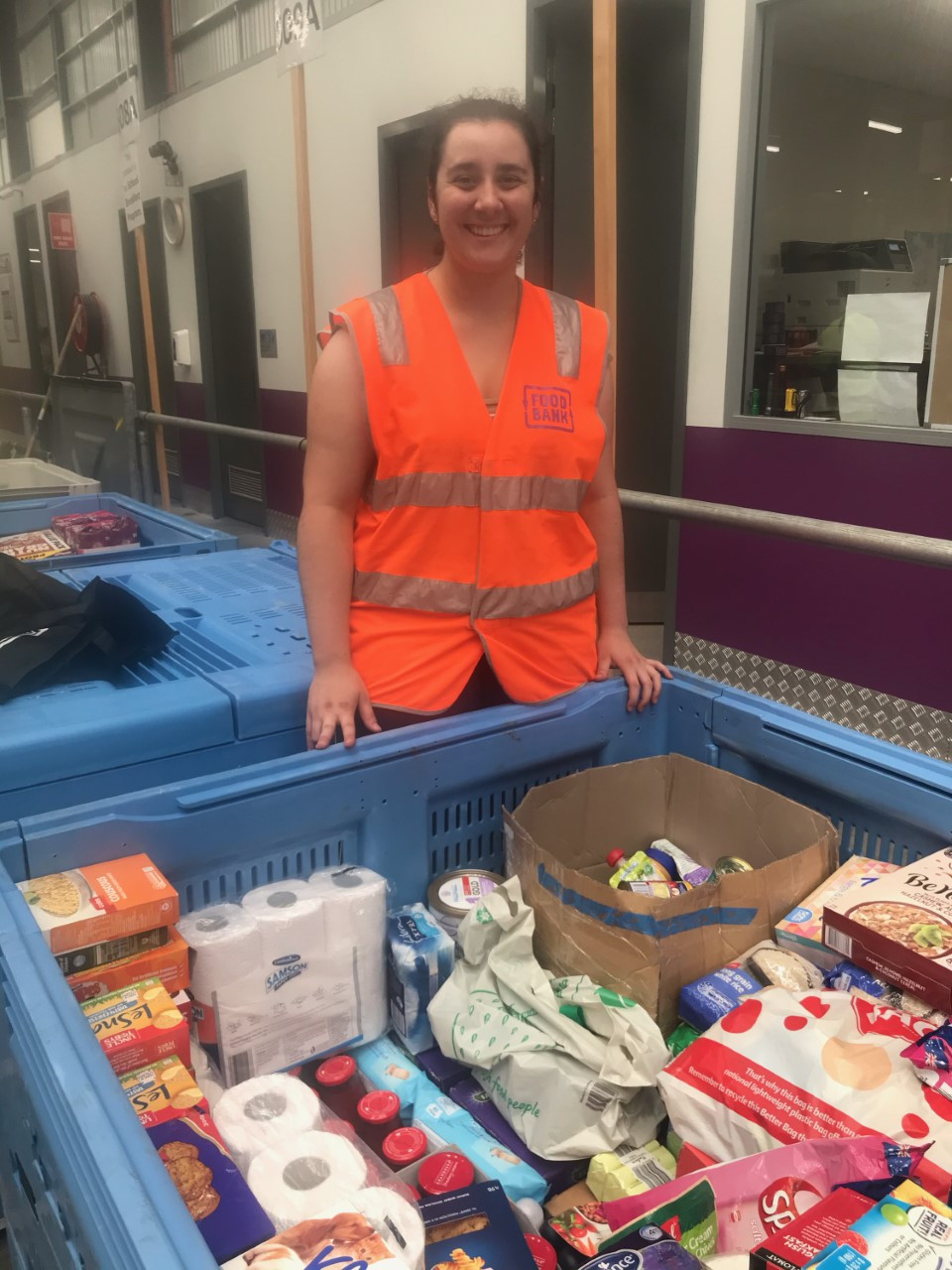 Me packing an industrial bin for bushfire relief donations. Foodbank NSW/ACT Warehouse, Glendenning NSW, January 2020.