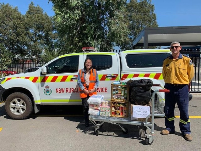 Kathleen Notohamiprodjo, fellow GLP-er and Foodbank intern, receiving food donations from an RFS representative at the Foodbank NSW/ACT Warehouse, Glendenning NSW, February 2020. (Image supplied by Kathleen).