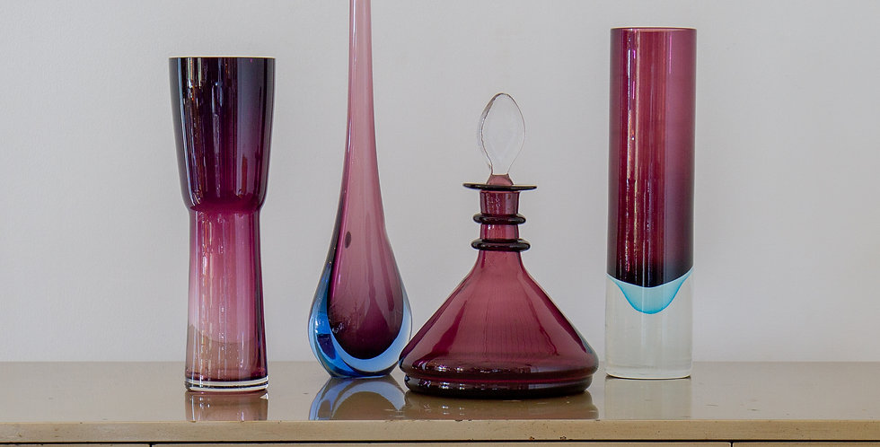 A Group of Four Plum Purple Glass Vases