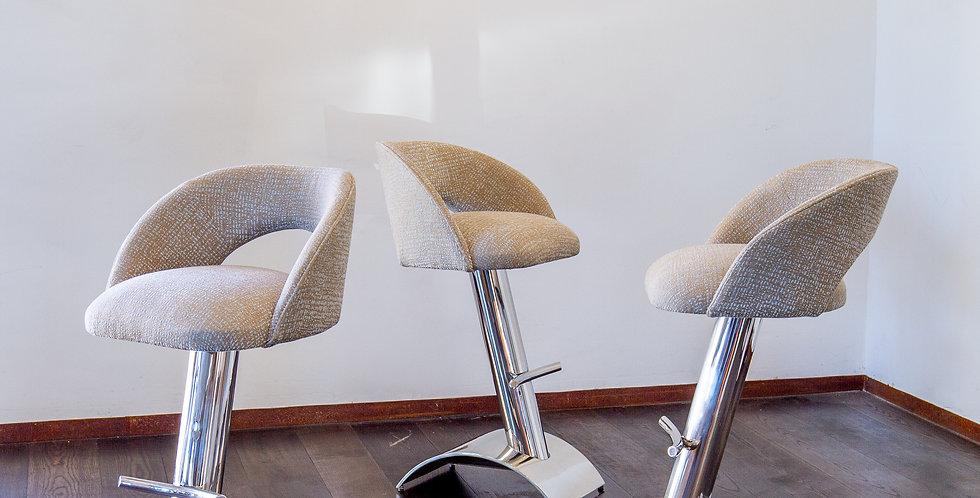 A Set of Three Italian Chrome Framed Upholstered Bar Stools
