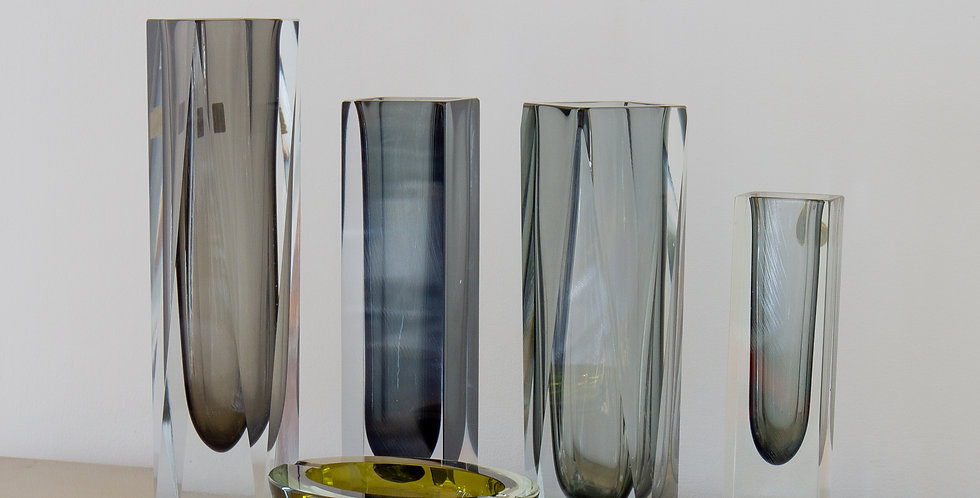 A Group of Four Charcoal Vases and an Ashtray