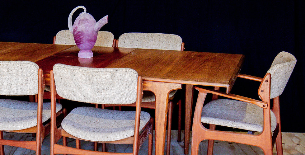 A Danish Teak Extendable Dining Table and Six Erik Buck Dining Chairs, 1950s