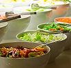 Salad bar. Fresh vegetables in a white b