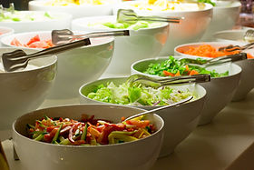 Salad bar. Fresh vegetables in a white b