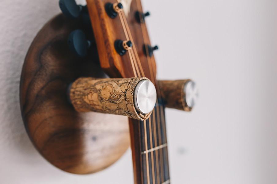 walnut guitar wall hanger with emerald root cork