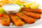 Fried fish fingers, French fries and veg
