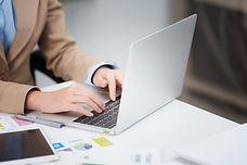 closeup-female-hand-typing-on-laptop-key