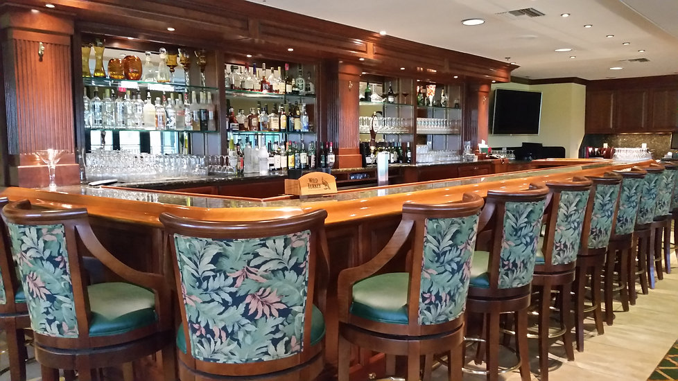 The handsome bar in the HSGC lounge is a popular gathering spot.