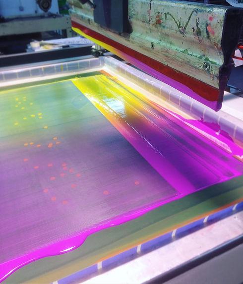 Fluro pink ink being screen printed