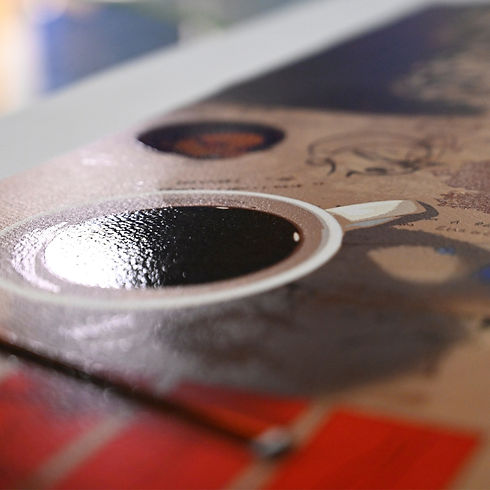 Detial of a screen printed gloss varnish on a giclee print