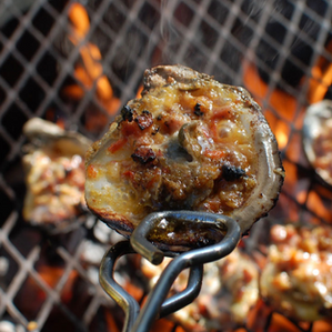Grilled Gulf Oysters with Smoked Sausage and Pork Rind Crumble