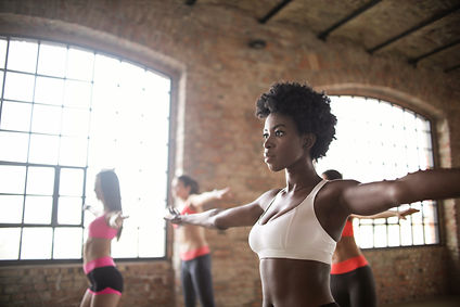 black woman in sports bra taking dance f