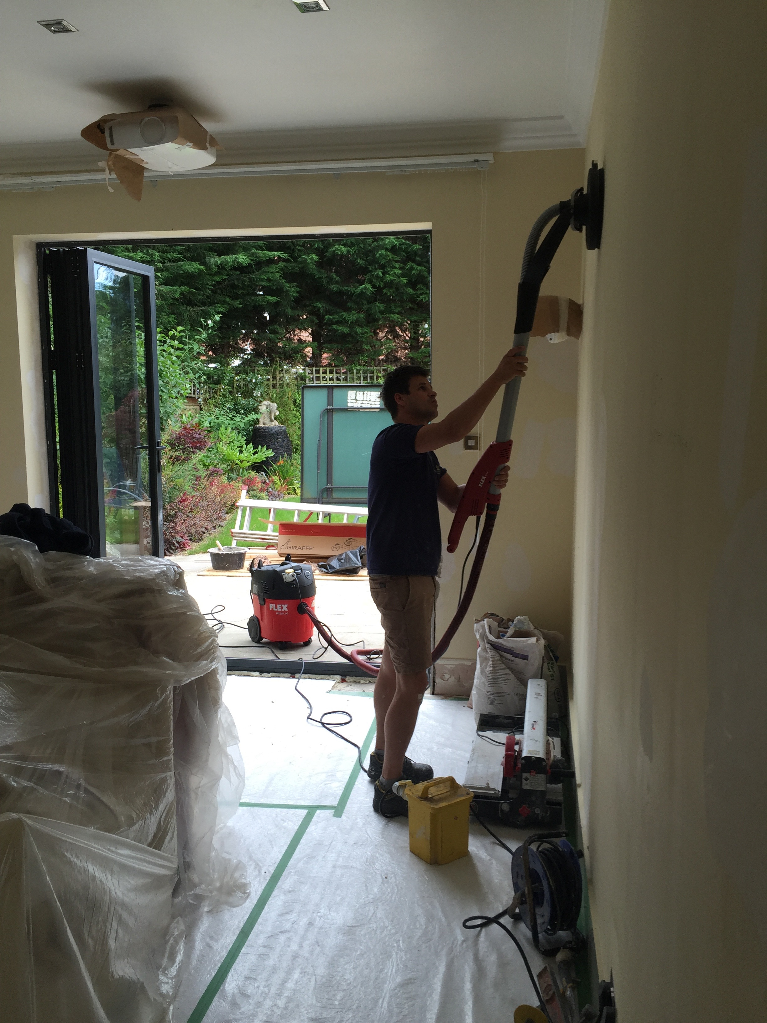 SANDING THE WALL TO SMOOTHEST FINISH