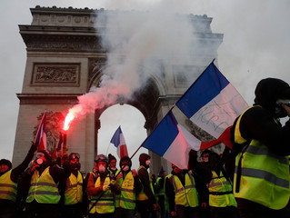 Macron goes back on rising fuel tax to appease protestors