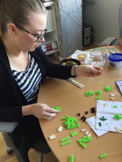 Jenn mastering LEGOs