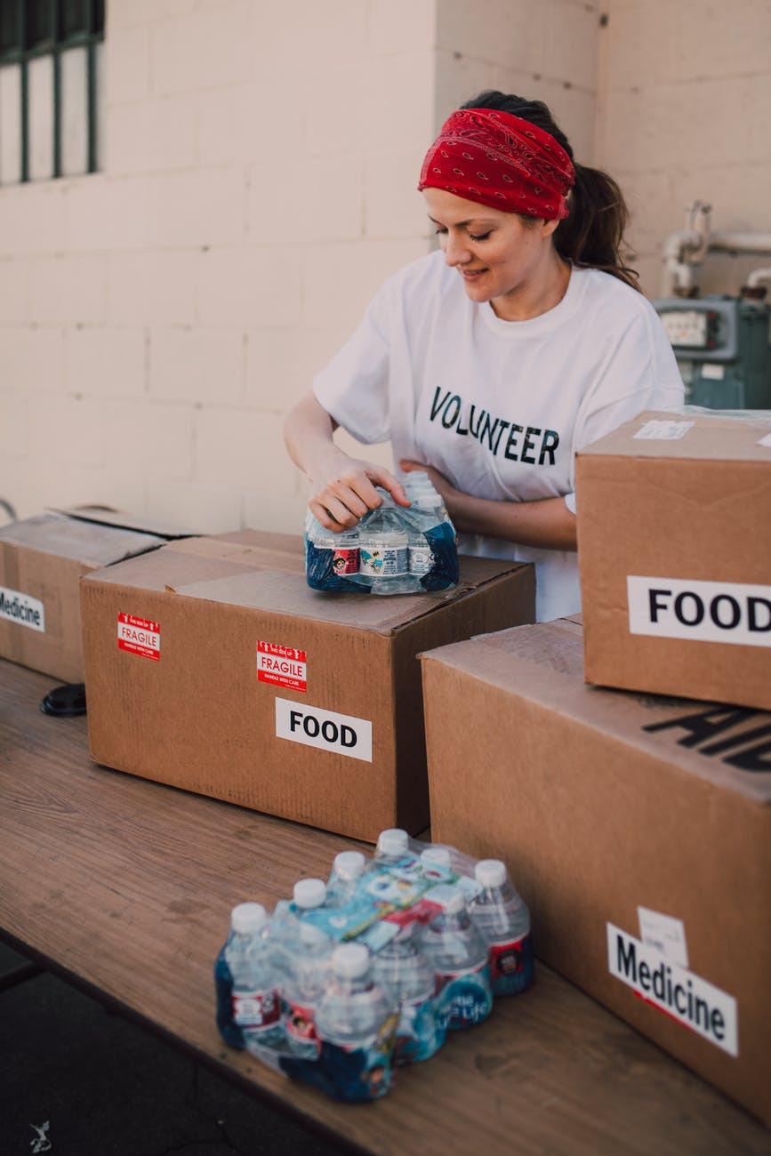Volunteer Packing Charity Food Boxes