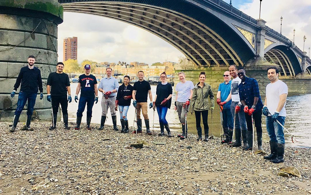 Cleaning rubbish on River bank for charity