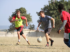 American and South African boys playing soccer together. Creating connectins through service and soccer across cultures.
