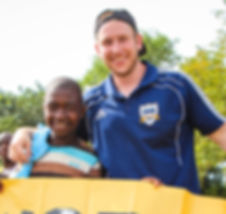 Chris Kaimmer and South African boy bonding through soccer service