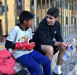 American and Peruvian soccer players bonding through soccer. Service Through Soccer