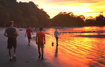 Playing soccer on the beach at sunset in Costa Rica