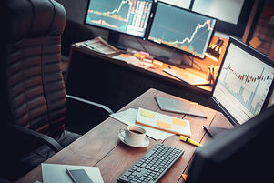 Stock trader workplace with financial ma