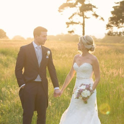 Wedding sunset couple in a meadow