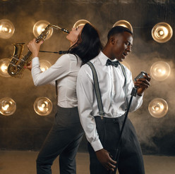 male-jazz-performer-and-female-saxophoni