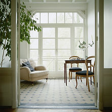 Serene white room with dining table and sofa