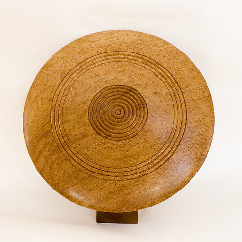 Discus art form in plane and sapele