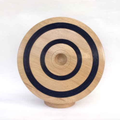 Discus art form in beech with leather cord inlay