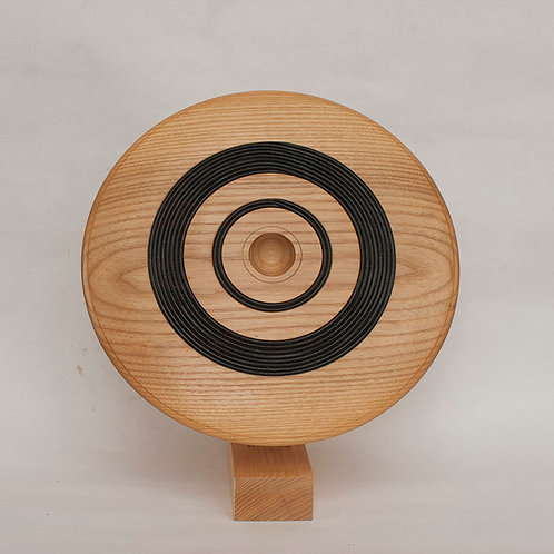 Discus art form in ash with leather cord inlay