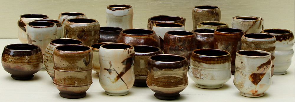 Shino cups, porcelain and black clay