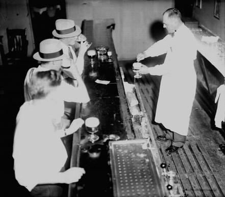 Patrons enjoying illegal booze