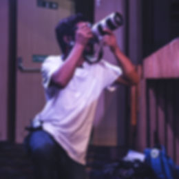 Photographer clicking photos in an event in New delhi, Videographer using a high quality camera during an event.
