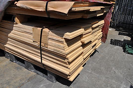 A stack of wooden boards for shelving
