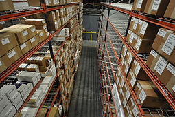 Orange pallet racking in th warehouse filled with boxes