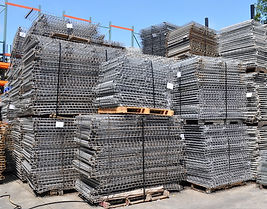 Stack of wired deck pallets for pallet racks different sizes